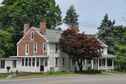 Pictured - Cobb's Tavern: A structure in Sharon MA originally built in the 1940s that has been converted into a private residence. Photo credit: Wikimedia Commons.